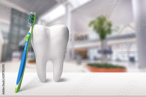 Big tooth and dentist mirror in dentist clinic on background Canvas-taulu