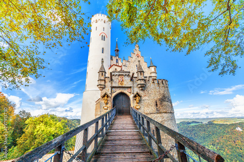 Montage in der Fensternische Altes Gebaude Germany, Lichtenstein Castle in Baden-Wurttemberg land in Swabian Alps. Seasonal panorama of Lichtenstein Castle on a cliff circled by colorful trees, German countryside . European famous landmark.
