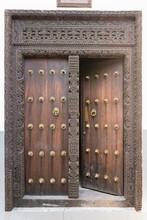 Old Wooden Door In Stone Town In Zanzibar Island, In The Historic Center