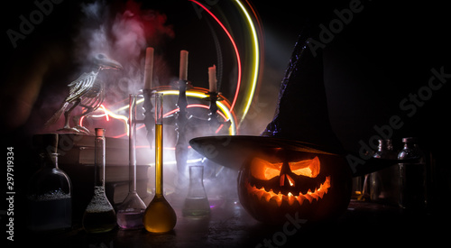 Fotografía  Halloween still-life background with different elements on dark toned foggy background