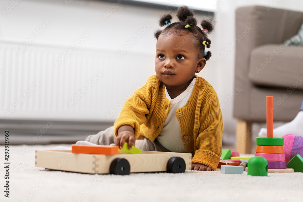 Fototapety, obrazy: childhood and people concept - little african american baby girl playing with toy blocks at home