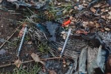 Used Syringes Lie On The Ground. Drug Addiction, Death 1
