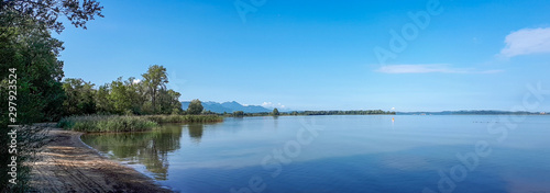 Foto auf Gartenposter Blau Sunny landscape with calm lake Chiemsee and blue sky, panoramic view