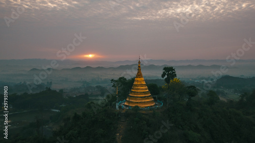 Drone Shot of the Shwetaung Paya Pagoda during Sunrise in Mrauk U, Myanmar with Misty Padgodas in the background Canvas Print