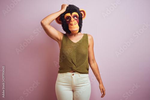 Fotobehang Aap Woman standing wearing t-shirt and monkey mask