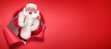 Emotional Santa Claus On The Red Background.