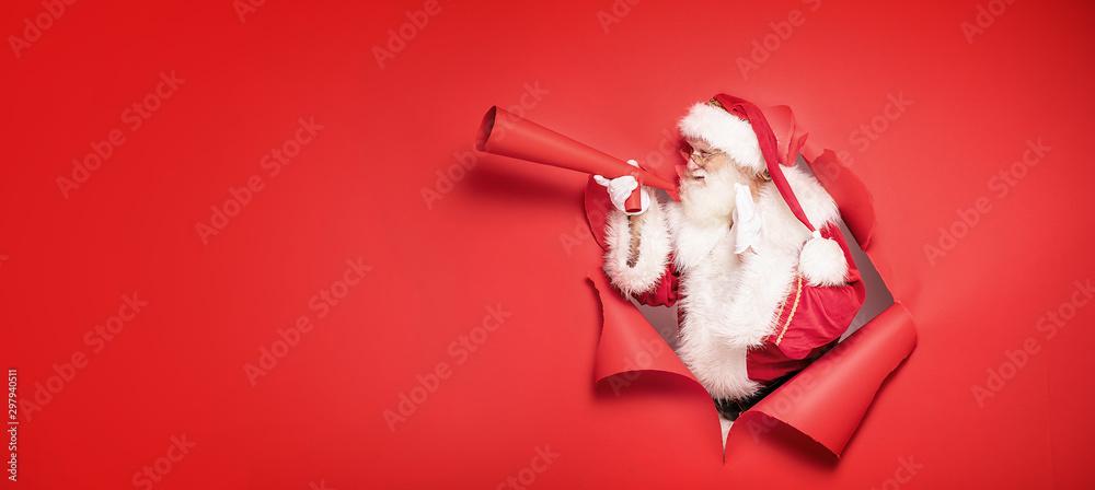 Fototapety, obrazy: Santa Claus screaming by megaphone.