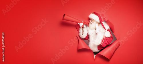 Obraz Santa Claus screaming by megaphone. - fototapety do salonu