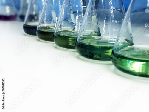 The Erlenmeyer or Conical flask on bench laboratory, with green solvent from forming reaction between boric acid and ammonia solution analysis concentration in wastewater sample Wallpaper Mural