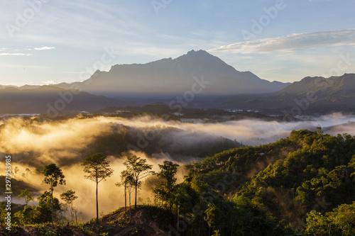 Amazing Beautiful Nature landscape view of Sunrise with nature misty foggy and Mount Kinabalu, Sabah, Borneo