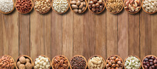 Various Nuts And Seeds On Wooden Table With Copy Space.  Healthy Food Background