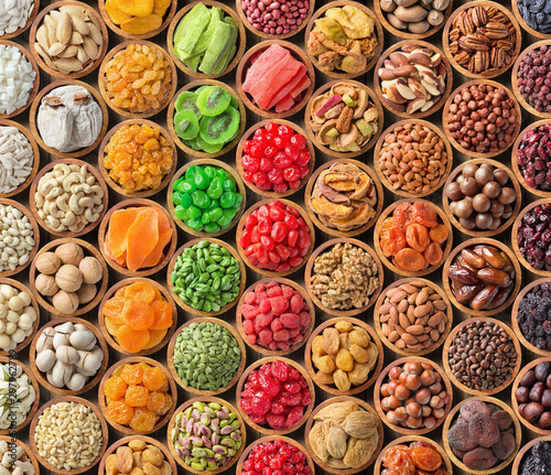 obraz lub plakat collection of dried fruit and nuts background, healthy snacks for vegan.