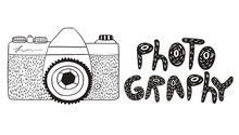 Photo Camera In Doodle Style With The Inscription Isolated On White Background.