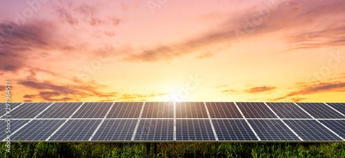 Fototapeta Solar panel on dramatic sunset sky background, Alternative energy concept obraz