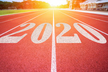 White Lines Of Stadium And Texture Of Running Racetrack Red Rubber Racetracks With 2020 Happy New Year Text,During Christmas And New Year.