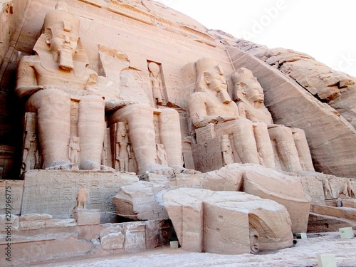 Fotografia, Obraz  The fallen Pharaoh head on the ground before the Great Temple, Abu Simbel in Egyptian, in Nubia village in Egypt
