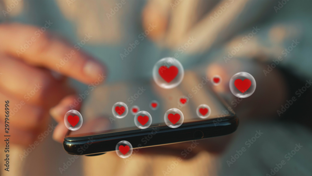 Fototapeta Woman hand browse popular content on smartphone screen. Close up