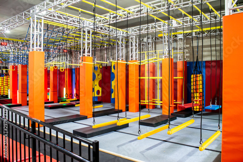 Stampa su Tela Brightly coloured interior ninja warrior parkour gym obstacle course with aerial