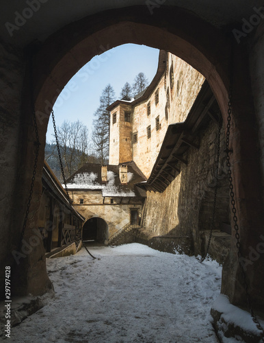 Photo  Main gate with drawbridge in the outer bailey (courtyard) at Orava Castle, Oravs