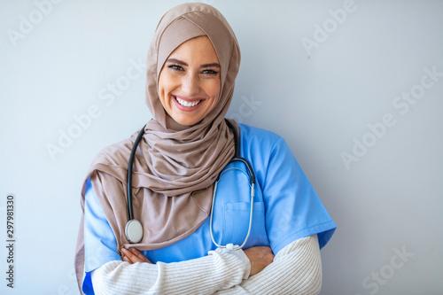 Confident Muslim female doctor standing inside hospital Canvas Print