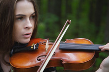 Portrait Close Up Of A Beautiful Girl Violinist Who Looking Forward Enthusiastically Playing The Violin Romantic Work