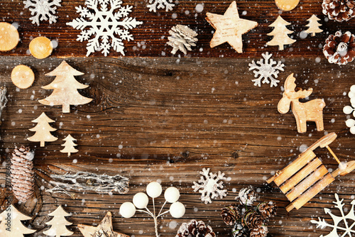 Frame Of Christmas Decoration Like Tree, Sled, Star, Fir Cone And Snowflakes. Rustic Brown Wooden Background With Copy Space