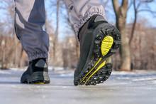 Male Or Female Winter Boots Walking On Snowy Sleet Road
