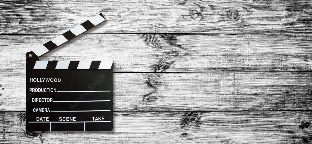 Movie clapper board on wooden background