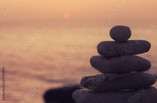 Spoed Fotobehang Stenen in het Zand Zen concept. Sunset. The object of the stones on the beach at sunset. Relax & Meditation.