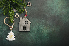 Festive Background With Toy Wooden House Christmas Tree And Decoration. Copy Space, Winter Holidays Greeting Card, Flat Lay, Top View.
