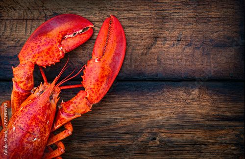 Steamed lobster seafood on wood background Wallpaper Mural