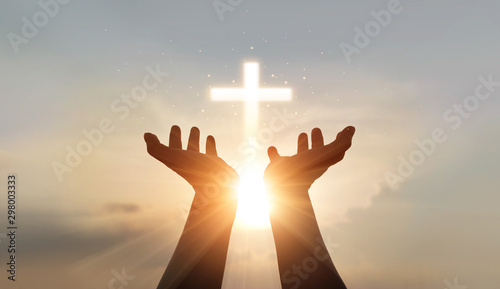 Man hands palm up praying and worship of cross, eucharist therapy bless god helping, hope and faith, christian religion concept on sunset background Fototapete
