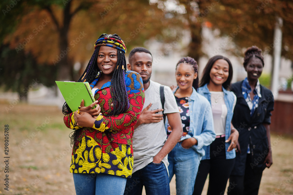 Fototapety, obrazy: Row of group five african college students spending time together on campus at university yard. Black afro friends studying. Education theme.