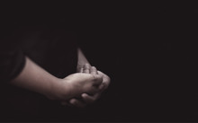 Praying Hands Concentrating Attentively And Meditation On Beliefs Or Hope Background. Gestures Of Hands And Mourning With Soul.
