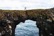 Tourist Jumps Over A Natural R...