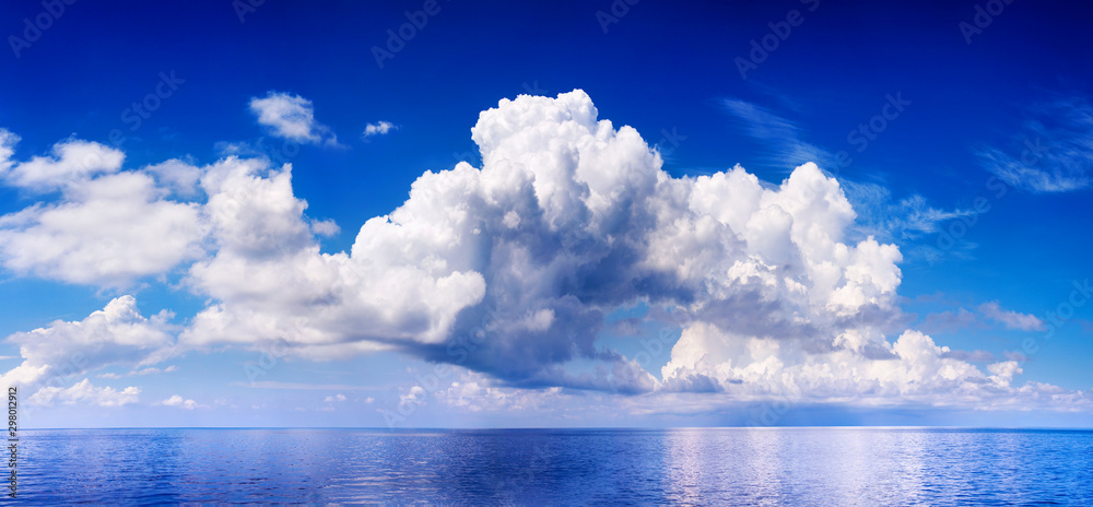 Fototapety, obrazy: White cumulus clouds in blue sky over sea landscape, big cloud above ocean water panorama, horizon, beautiful tropical sunny summer day seascape panoramic view, cloudy weather, cloudscape, copy space