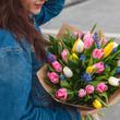 tulips bouquet in girl hands