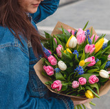 Fototapeta Tulipany - tulips bouquet in girl hands