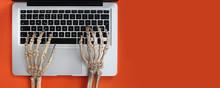 Skeleton Hands Typing On Laptop