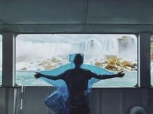 Rear View Of Man Looking Water...