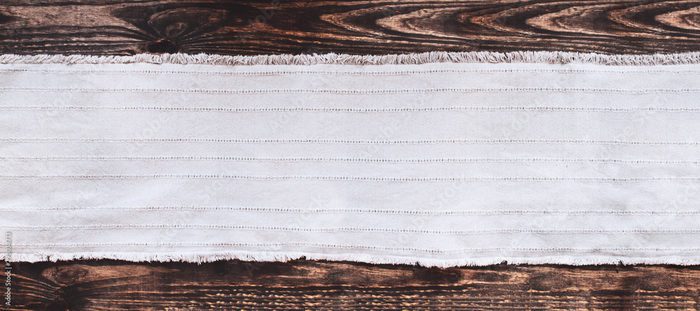 Fototapety, obrazy: Grey fabric runner on an old wooden rustic table background with copy space. Top view.