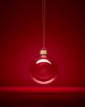 Glass Christmas Bauble Hanging In Front Of Luxury Dark Red Background.