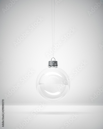 Fotomural  Stylish Glass Christmas bauble on white Studio background for winter holiday greeting card