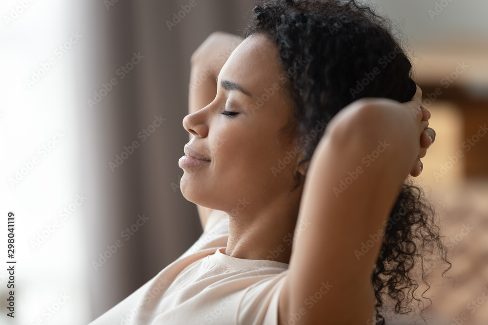 Fototapeta Close up of calm black woman relax with eyes closed