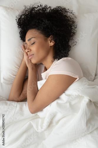 Fotografie, Obraz Top view of peaceful black girl sleeping in white bed