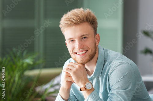 Fotomural  Portrait of stylish young man at home