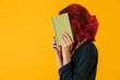 Image of caucasian woman covering her face exercise book