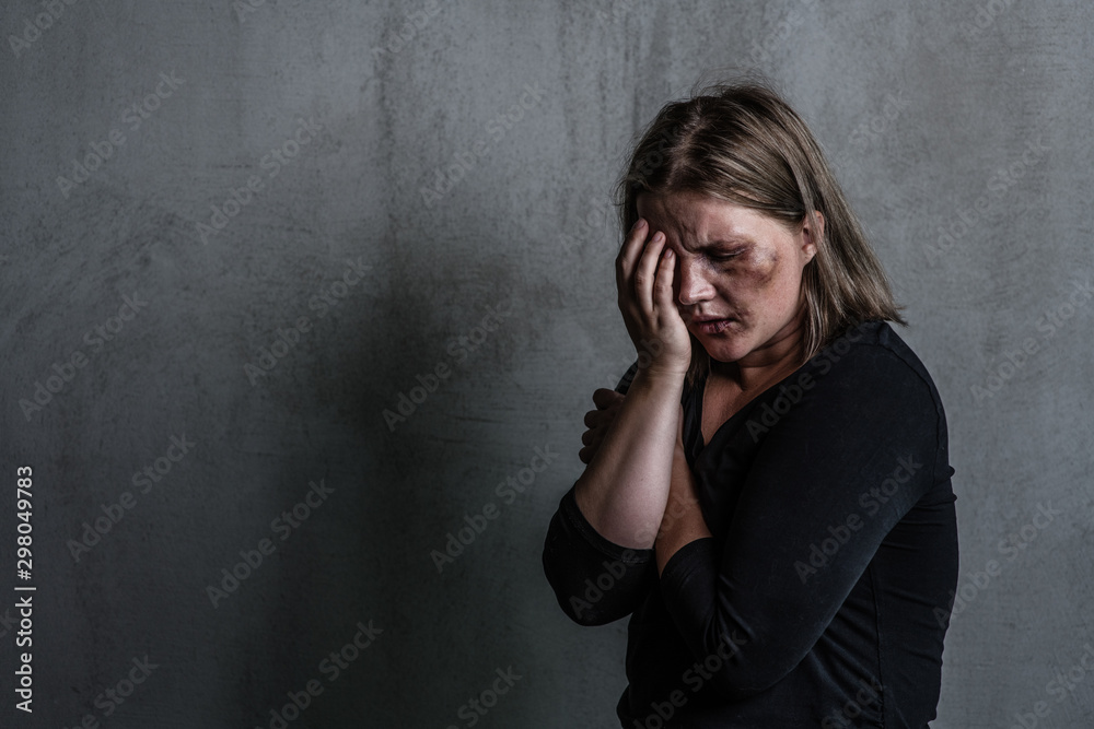 Fototapeta Crying woman victim of domestic violence and abuse. Empty space for text