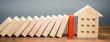 Leinwanddruck Bild - Wooden blocks of dominoes fall on a miniature house. Real estate insurance. Management of risks. Security. Private property protection. Home accident insurance concept