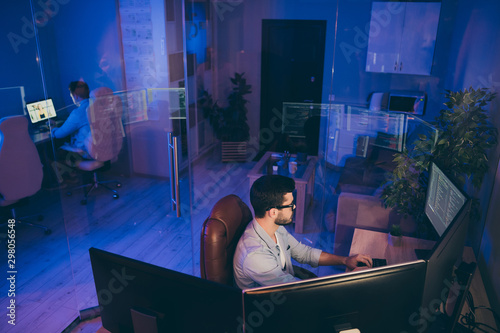 Profile photo of it specialist guy sitting chair work late at night seriously lo Canvas Print